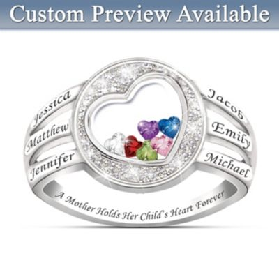 A Mother Holds Her Child's Heart Birthstone Ring With Names by